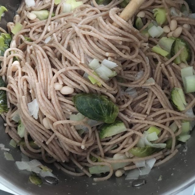Spelt spaghetti roasted brussels sprouts sauted leeks white navy beanshellip