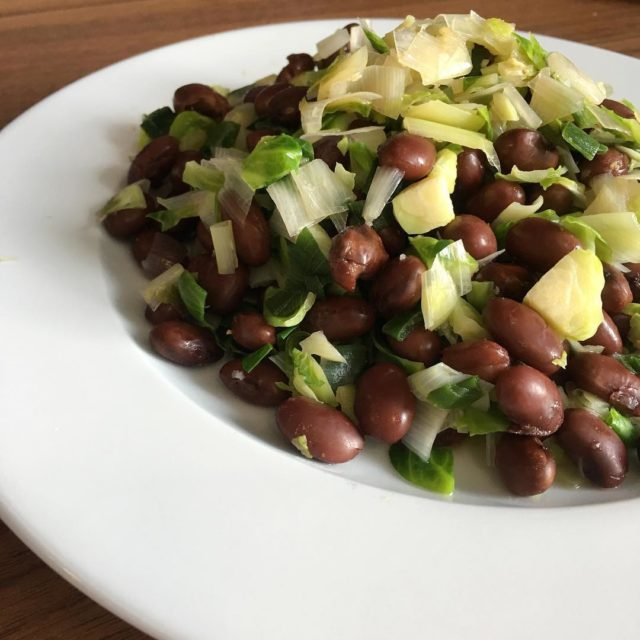 Red beans with water sauted Brussels sprouts leeks and greenhellip